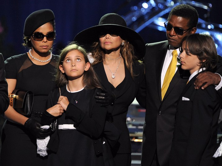 "From left, Michael Jackson's sister Janet Jackson, daughter Paris, sister LaToya Jackson, brother Jermaine Jackson and oldest son Prince Michael I attend a memorial service for the ""King of Pop"" at the Staples Center in Los Angeleson July 7, 2009.  AFP PHOTO/GABRIEL BOUYS/POOL (Photo credit should read GABRIEL BOUYS/AFP/Getty Images)"