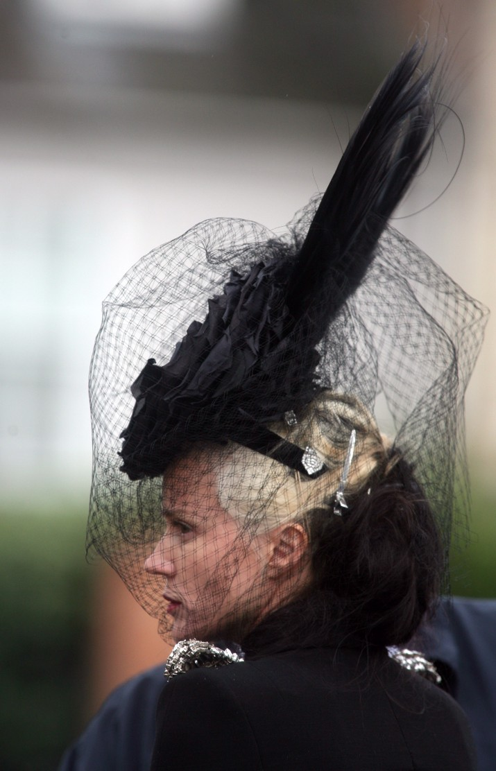 GLOUCESTER, UNITED KINGDOM - MAY 15:  A mourner attends the funeral service for fashion stylist Isabella Blow at Gloucester Cathedral on May 15 2007 in Gloucester England. The 48-year-old - who will be buried in one of her trademark hats - died last week after drinking weed killer. Designer Alexander McQueen, model Sophie Dahl and actor Rupert Everett were amongst the guest paying their respects  (Photo by Matt Cardy/Getty Images)