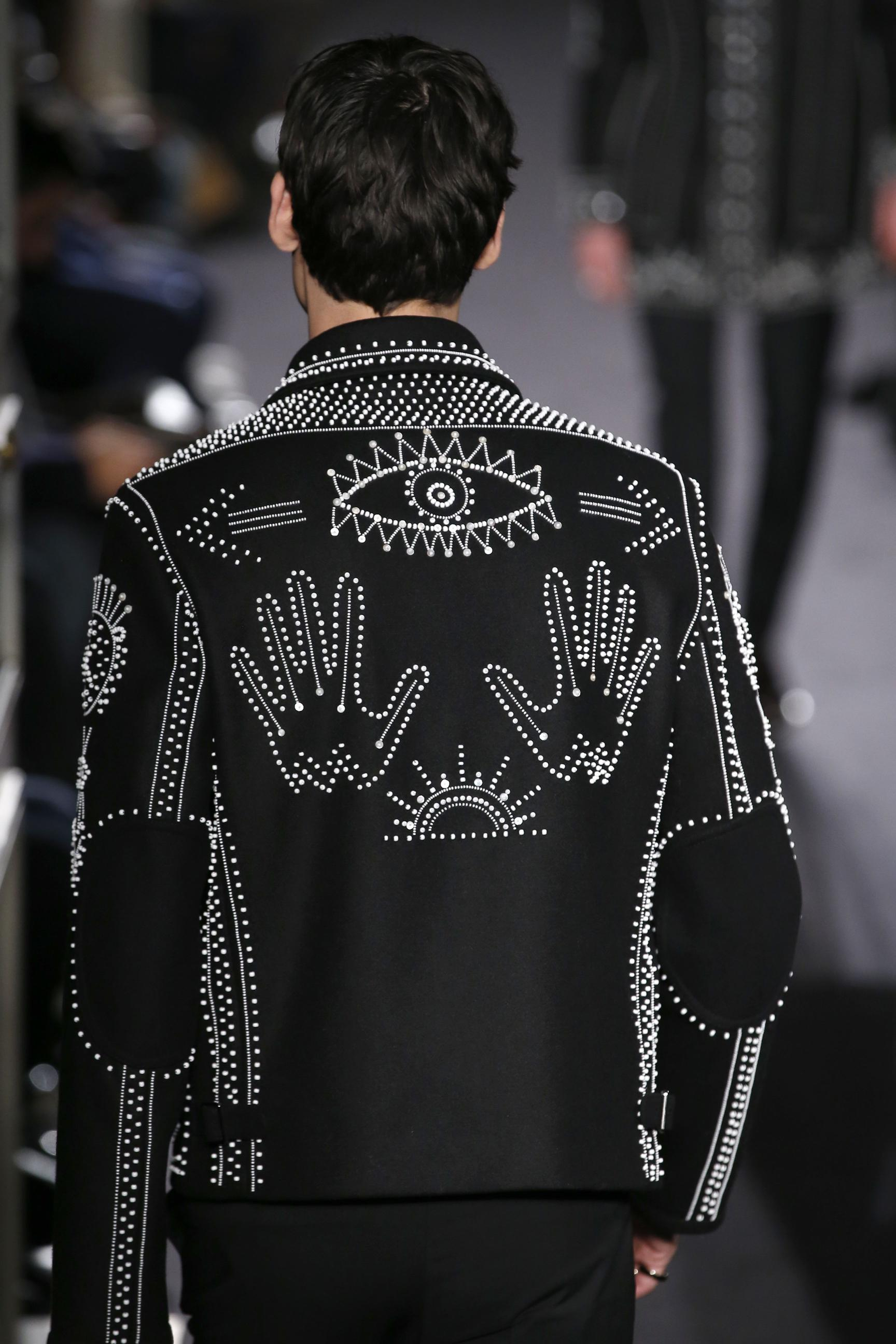 A model presents a creation by Valentino during men's Fashion Week for the Fall/Winter 2016/2017 collection in Paris on January 20, 2016. / AFP / PATRICK KOVARIK (Photo credit should read PATRICK KOVARIK/AFP/Getty Images)