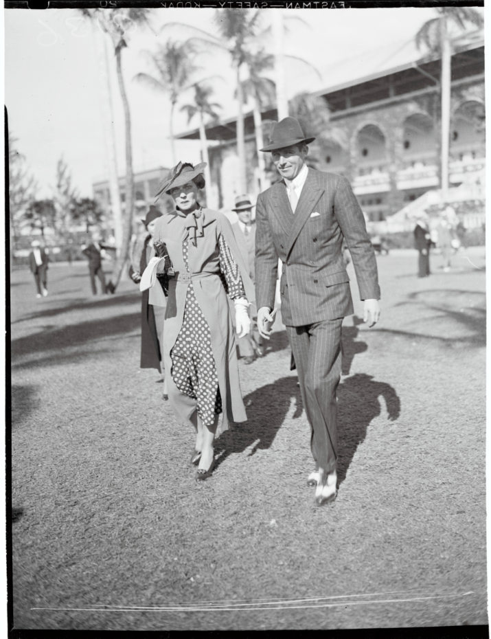 "(Original Caption) Mrs. Harrison Williams, ""world's best dressed woman"" and Mr. Thomas W. Durant pictured at the Hialeah Race Track, Fla., recently."