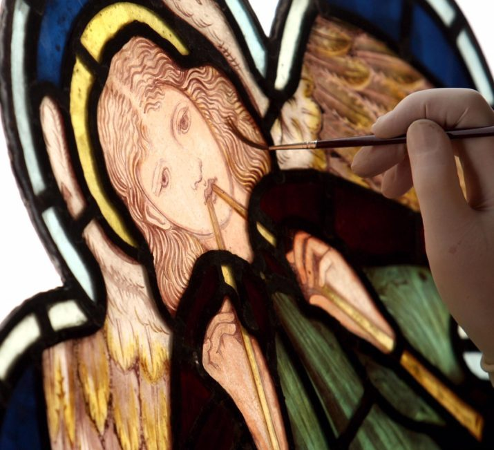 Susan Matthews, curator of the Stained Glass Museum at Ely Cathedral, Ely, Cambridgeshire, works on a Cinquefoil Stained window depicting a Minstrel Angel by William Morris. (Photo by Chris Radburn - PA Images/PA Images via Getty Images)