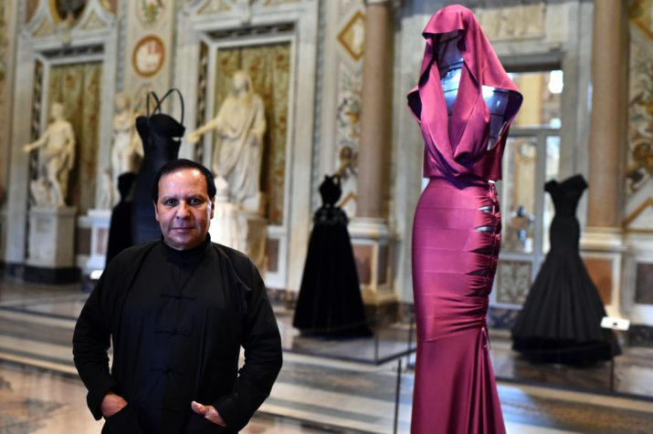 "Tunisian-born, Paris-based couturier Azzedine Alaia poses during the press preview of the exhibition "" Azzedine Alaia's soft sculpture"" at the Galleria Borghese in Rome on July 10, 2015. The exhibition will run from July 11 to October 25, 2015. Visitors can see Alaia's work displayed in the middle of the permanent collection of scluptures and furnitures of the Villa Borghese.  AFP PHOTO / GABRIEL BOUYS        (Photo credit should read GABRIEL BOUYS/AFP/Getty Images)"